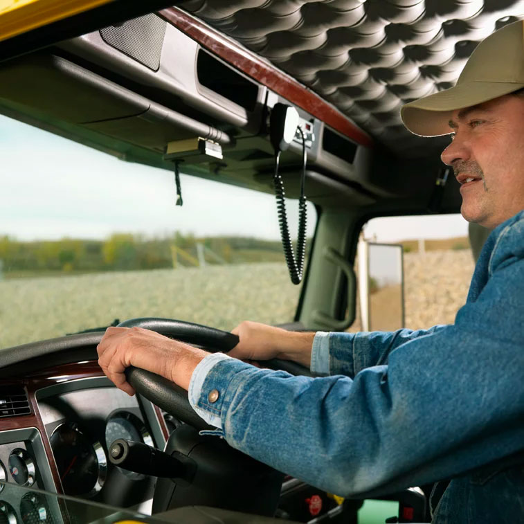 Truck driver behind the wheel of a commercial truck