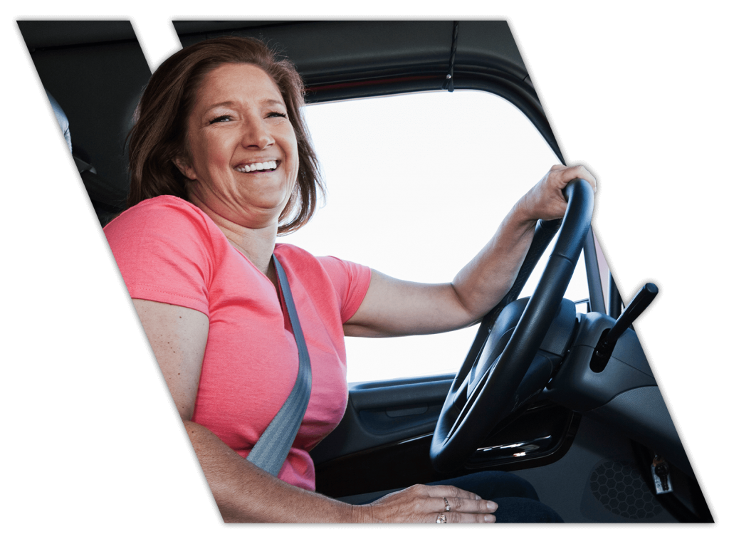 Female truck driving student doing on-the-road training